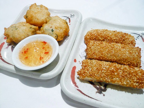squid cakes and sesame prawn paper rolls